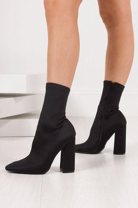 BEBE Black Lycra Block Heel Sock Boots